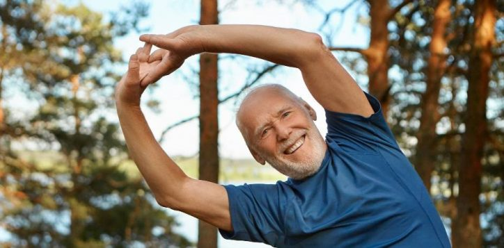 outdoor-shot-of-happy-energetic-senior-retired-man-enjoying-physical-training-in-park-doing-side-bends-exercise-holding-hands-together-with-broad-smile-warming-up-body-before-run1-2